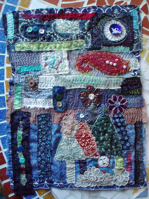 """awesome messy patched ground *then embroidered, beaded & more* art piece, probably meant to be a wall-hanging...  *called """"slow cloth"""" by Createarian."""