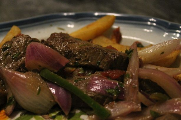 This dish is made of marinated steak, vegetables, And fried potatoes and it is sometimes served over rice. It is one of the most popular recipes in Peru. I am posting it for ZWT 2008. Based on reviews I have cut back on the amount of meat And jalapenos. Thanks for the great feedback...
