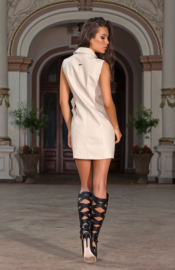 The Cera sleeveless jacket is a versatile fashion item. Layer with fine knits and jeans, or your favourite dress to create hundreds of adaptable looks or wear alone as a sexy mini dress. The soft neutral tones enhance sunkissed skin while the faux leather material and waist belt detail accentuate your curves.