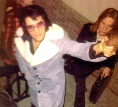 Elvis Presley Arriving at the Memphis International Airport to catch a flight to Los Angeles on January 12, 1974 - Elvis, along with Red West and Ricky Stanley were flying to the west coast to begin rehearsals for his next Vegas season, beginning January 26th