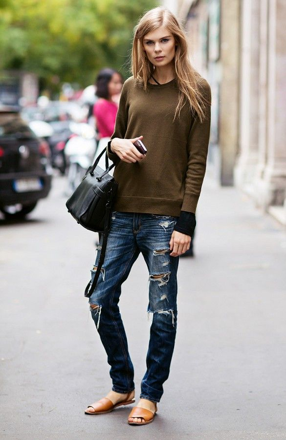 Style Tip: Pair your ultra-distressed denim with a simple sweater to copy this low-key, model-off-duty look.