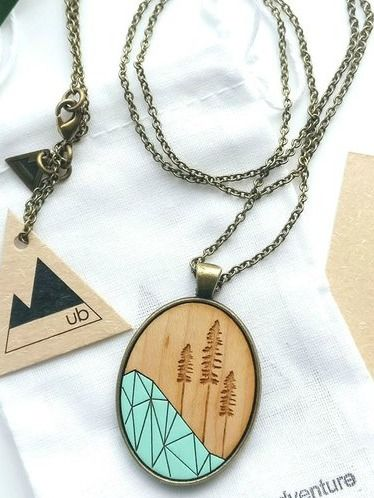 Geo Stika Necklace - Mint | An original laser wood cut creations, hand-painted and wrapped in brass. One size fits all!  #madeincanada #canadiandesigner #canadianbrands #canadianclothing #torontobeaches #kensingtonmarket #torontostyle #torontofashion #CanadianDesigners #torontofashionblogger #torontofashionista #madeinbc #canadianfashion #canadianfashionblogger #canadianmade #canadiancreatives #fashioncanada #jewellery #woodnecklace #woodpendant