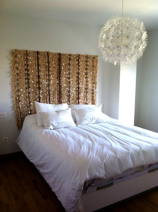 Moroccan wedding blanket as headboard, currently obsessed with these beautiful blankets.