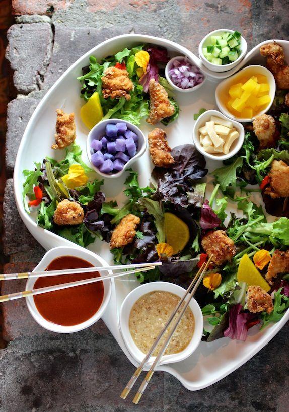 Korean Fried Chicken Salad DECONSTRUCTED  Soy & Rice Wine Marinated Fried Chicken Tenders, Mixed Lettuces, Yellow Pickled Radish, Bamboo Shoots, Seasoned Seaweed, Gochugaru Dressing, Pine Nut Vinaigrette