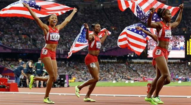 Allyson Felix, Carmelita Jeter, Bianca Knight and Tianna Madison of the United States celebrate after winning the gold medal in the 4x100 relay Friday, Aug. 10, 2012. The U.S. set a world record with a time of 40.82 seconds
