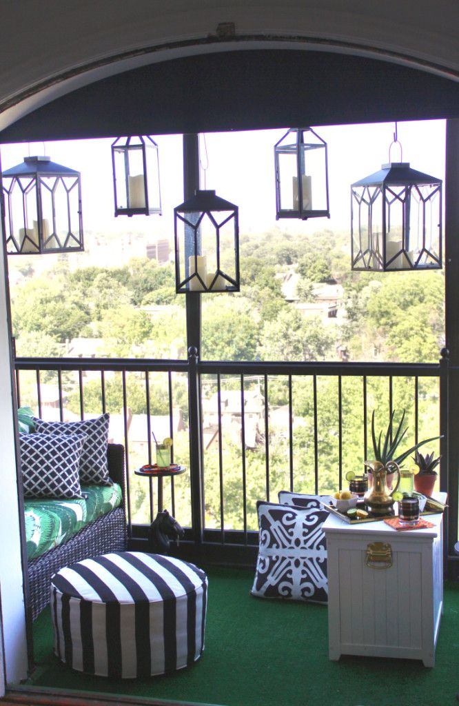 REVEAL // Viceroy Inspired Balcony Outdoor lanterns, outdoor love seats, black and white stripe pattern outdoor throw pillows, outdoor ottoman, banana palm leaf print outdoor fabric, vintage brass pitcher, vintage cocktail glasses, HGTV Star, DIY, aloe plants, astro turf, high-rise pre-war, apartment building patio balcony terrace, outdoor entertaining