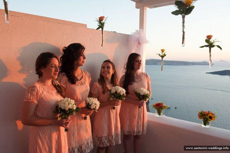 Bridesmaids and flowing roses #Santorini #weddings