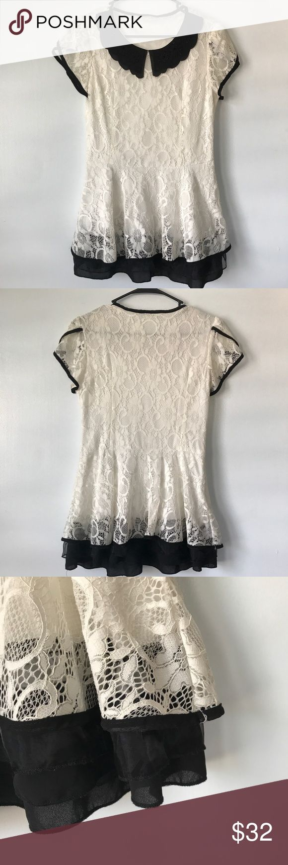 Lace peplum top Adorable black and white peplum top with black studded collar and tulip sleeves. Layered skirt. Excellent condition! Tops Blouses