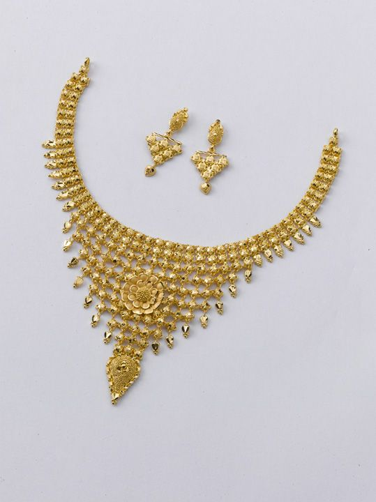 Here is something special from the gold factory: Necklace weight 16 gm price ~ Rs.60,000.0  Earring weight 4 gm price approx Rs.19000.0
