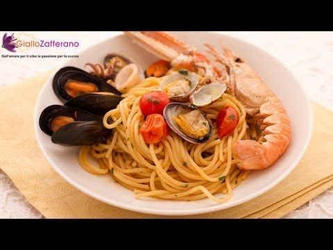 Seafood spaghetti -italian recipe, can be found on almost every Italian restaurant menu, in a number of variants: this version is made with mussels, clams, squids and scampi!