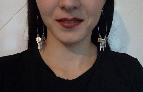 These boho earrings are handmade from nickel crystal beads,metal feather shape pendants,metal coin shape pendants,silver tone hoops and hooks. Length(including earring hook and feathers):10cm/3.9 long Diameter: 5.5cm/2.1 If you have any questions, do not hesitate to contact me.