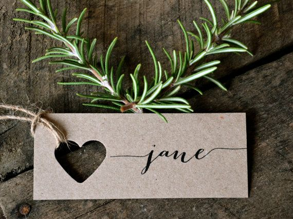 Wedding place cards/name tags by LaPommeEtLaPipe on Etsy. Inspiration. Use a different punch, not a heart.