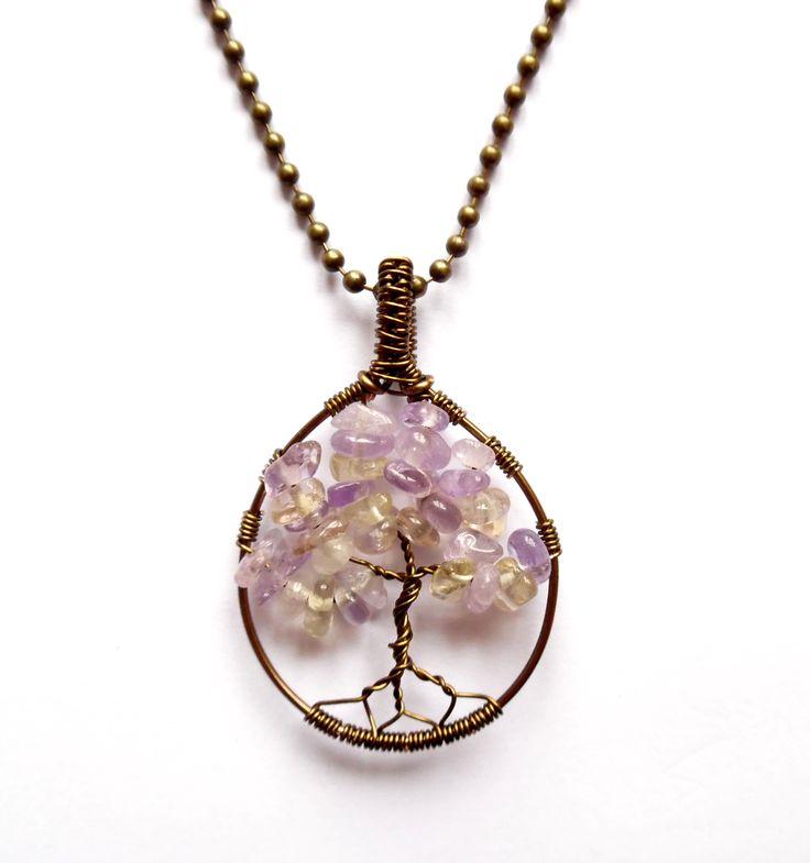 Halsband i brons med livets träd av ametrin.  Varje smycke är unikt.  Kulkedja ingår  Längd: 55cm  Hängets storlek: 5cm