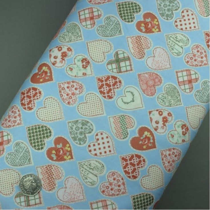 Blue fabric with patchwork hearts 100% cotton - sold per metre