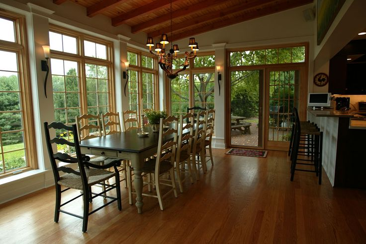 Airy dining room love the walls of floor ceiling length for Sunroom dining room ideas