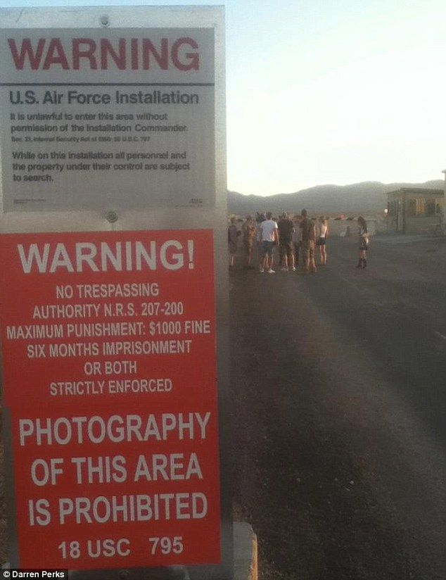 Do not enter: The moment the team sneak into Area 51 - and security teams immediately step in to arrest them <==Not really No Security!  Barney Fife and the US Military are awake now - no need to worry 0_0