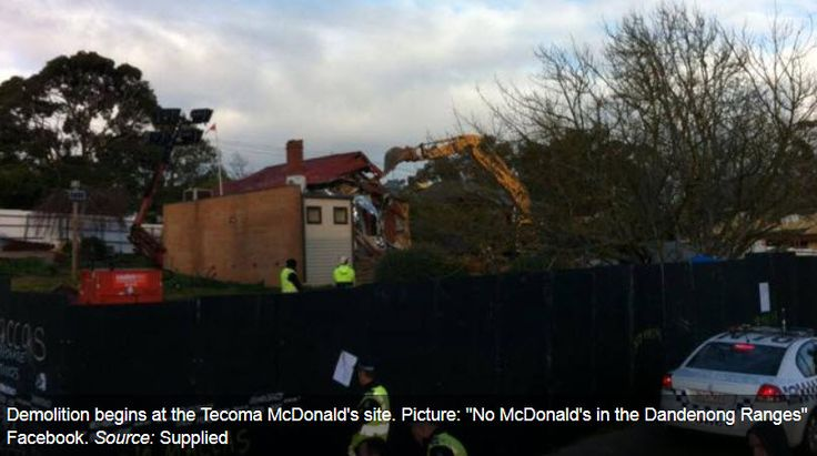 DEMOLITION work has finally started at the notorious Tecoma McDonald's site.  Protesters shed tears this morning as an excavator tore down two buildings on the site where the fast food outlet will be built, but they declared the destruction would not temper their fight against the controversial development.  About 100 protesters returned to the site today and watched the demolition from the sidelines, Ms Freeman said.