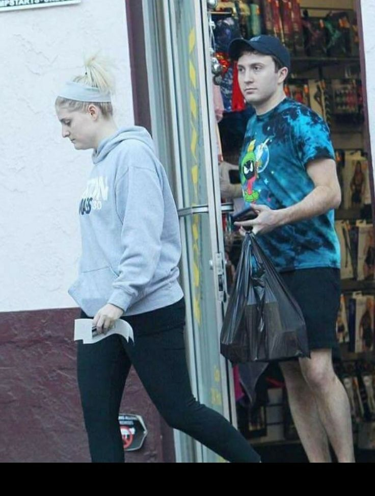 Meghan Trainor and Juni Cortez (Spy Kids main character) leaving a sex shop with a bag of dildos