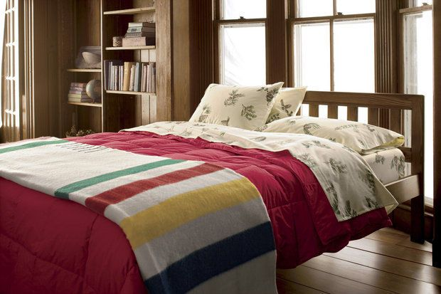 Point blankets in the familiar color stripe pattern were traded with First Nations peoples and Native Americans as far back as the reign of Queen Anne, with the Hudson's Bay Company commissioning the design in 1800. This new one is from L.L. Bean