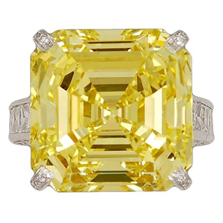 CHATILA Fancy Intense Yellow Diamond Ring  USA  Modern  Chatila Platinum Fancy Intense Yellow Diamond Ring. FIY - 23.17cts. and princess cut diamond - 3.14cts. w/ GIA Certificate - WOW