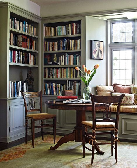 Cozy reading nook with built in corner bookcases Built in reading nook