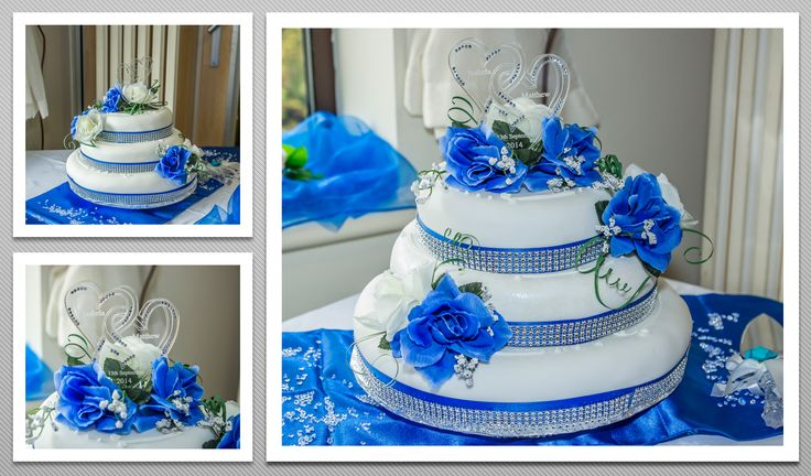 3 tier Wedding cake with blue flowers and ribbons, and personalised heart shaped cake toppers.