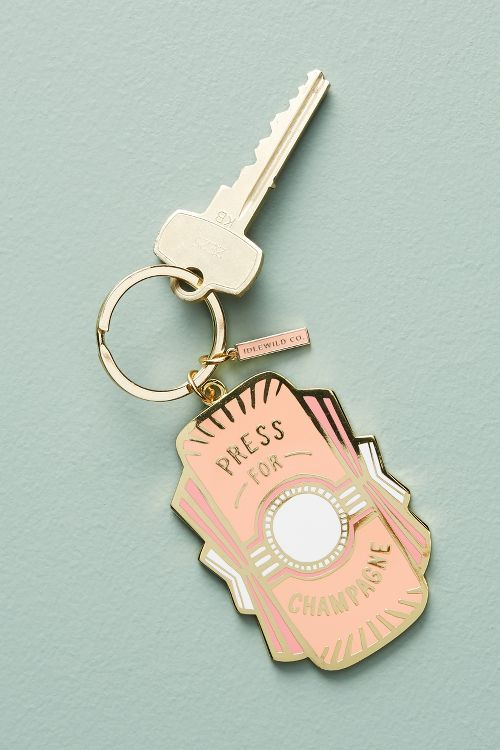 "Enamel Pink Charmed Keychain ""Press for Champagne"""