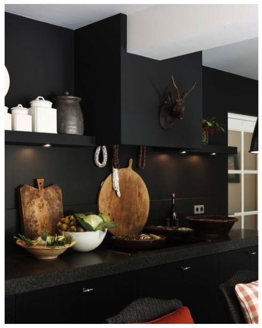 The boards and canisters are very striking against the black kitchen...