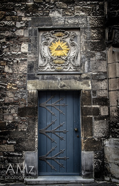 A golden glowing Pyramid and an iron-studded blue door - Aachen Cathedral, Aachen, North Rhine-Westphalia, Germany