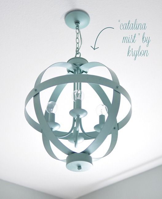 Many of you wanted to know about the color on the chandelier – I used a spray paint in the color 'Catalina Mist' by Krylon to change it from dark bronze to a minty aqua blue. The round light bulbs can be found at Home Depot. I used the same spray paint to cover the three frames that hang above the bed (frames found at Michaels.)