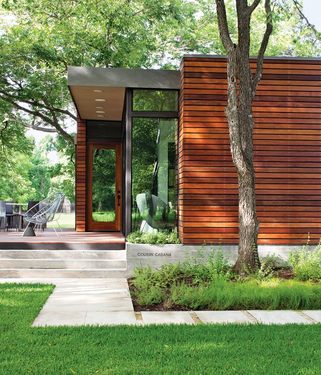 Landscape architect Tait Moring installed pavers around the structure's perimeter and kept the tree cover intact. Photo by: Kimberly Davi...