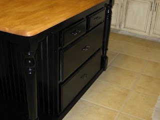 This housewife turned a regular ole kitchen table and a dresser into a kitchen island. SO. COOL.