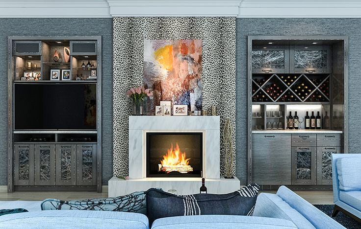 Custom built-in wall units around fireplace feature a bar and entertainment area. Specialty veneer and framed doors with Silver Spun resin add to the eclectic style. Bar features cross hatch wine racks and marble while the matching TV unit hide speakers behind framed speaker cloth. #InteriorDesign #HomeDecor #HomeImprovement Learn more: http://www.closetfactory.com/wall-units/