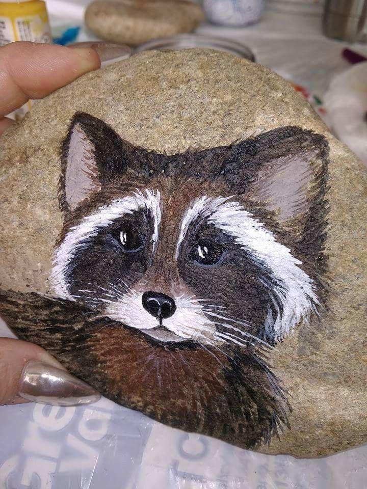 Rock painted like raccoon