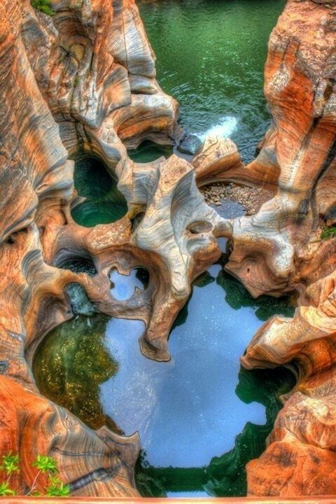Bourke's Luck Potholes. Potholes and plunge pools of the Treur River, Blyde River Canyon South Africa. Sustained kolks in the Treur River's plunge pools have eroded a number of cylindrical potholes or giant's kettles, which can be viewed from the crags above. It was named after a local prospector, Tom Bourke, who predicted the presence of gold.                                     #landscape #blyde #river #canyon #south #africa #photography