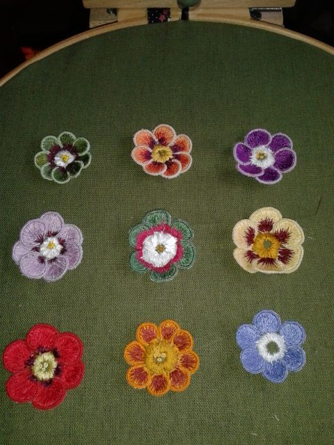 Finished Auricula embroidery Made by Adrienne Grice