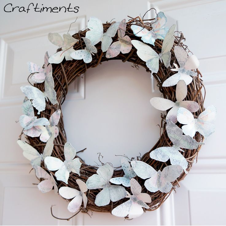 Paper butterflies glued to a grapevine wreath She tells you where to get the butterflies and how she did it. Description from pinterest.com. I searched for this on bing.com/images