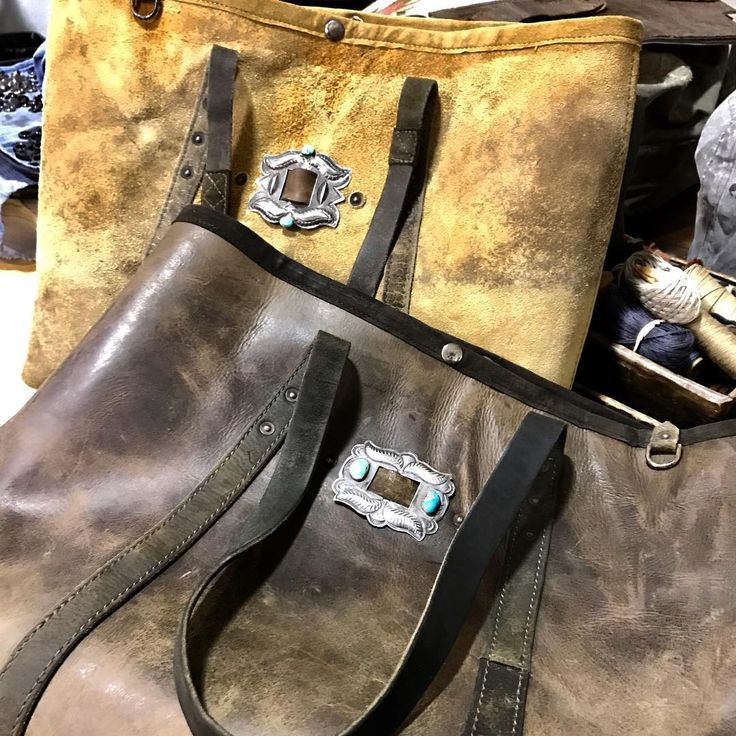 On the bench waiting for their trims...vintage chaps leather totes with sterling and turquoise conchos