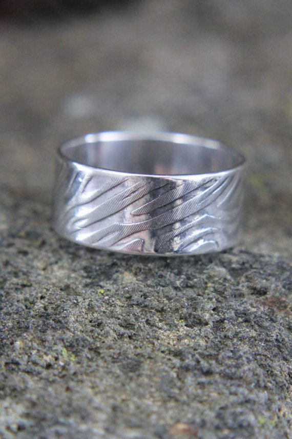 Eco-friendly Sterling Silver Wood Grain Pattern Ring. Makes a great wedding band for him, or a great unisex piece that can be dressy or casual.    This ring is made by recycling my silver scraps, processing it through a rolling mill, then imprinting the pattern from a brass plate. It is then formed into a ring shape and soldered into a band. The inside is  polished to a high shine followed by a light polish on the outside to highlight the raised areas.    #silverring #woodgrainring #ringband