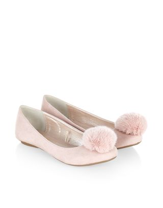 Topped with fluffy pom poms, our soft suedette ballerina shoes for girls are fun and fabulous for daytime and party looks. Flat, gripped soles provide a comfortable fit.