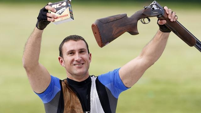 Croatia's Giovanni Cernogoraz holds up his weapon and a box of cartridges after winning the men's trap shooting final at the London 2012 Olympic Games at the Royal Artillery Barracks August 6, 2012
