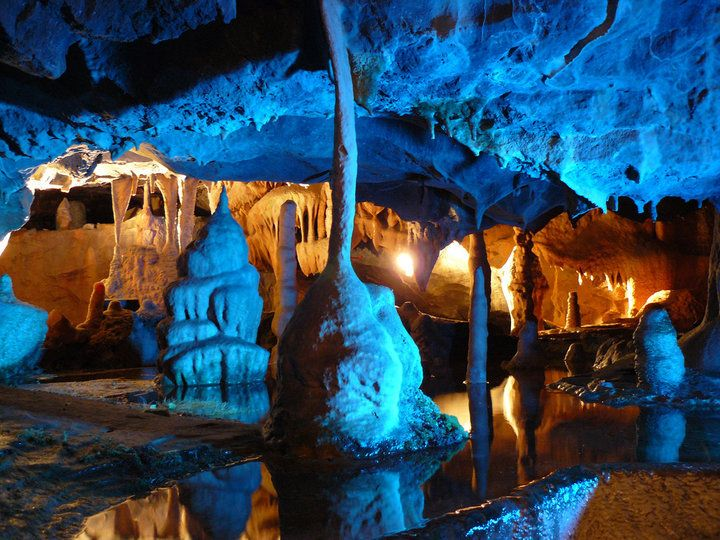 Cox's Cave, Cheddar Gorge, Somerset, England.  The approximately estimated travel/road distance from Shaftesbury to Cheddar Gorge can be around 36.13 miles to 39.28 miles