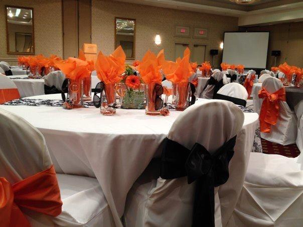 Graduation Banquet Orange, Black, And White Table Arrangement