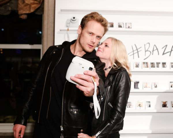 "NEW HQ Pic of Sam Heughan and MacKenzie Mauzy at ""ICONS"" Celebration by Harper's BAZAAR 