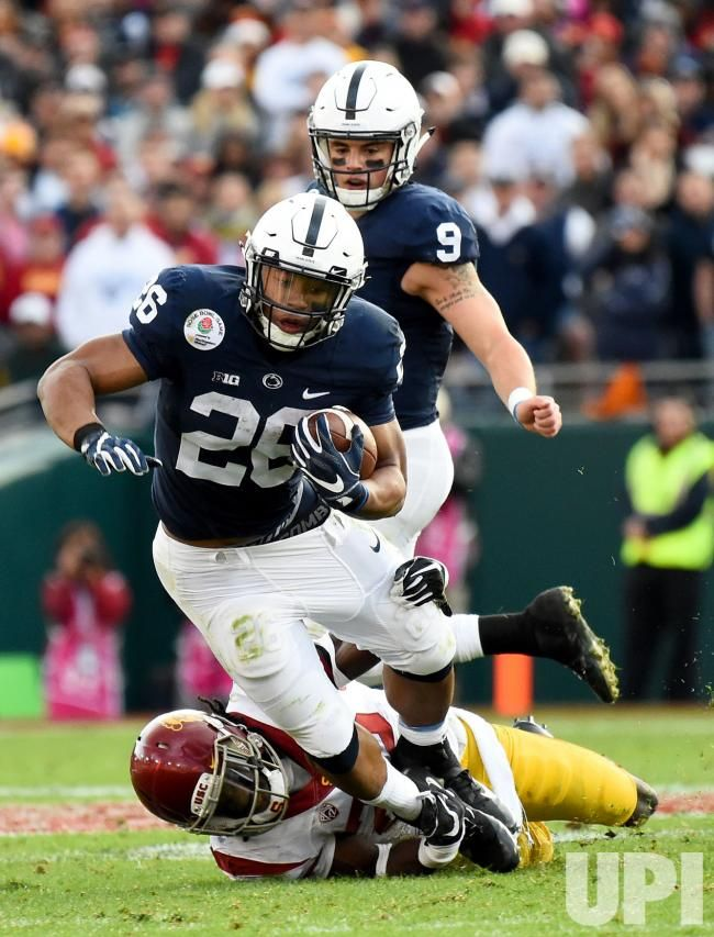 Penn State running back Saquon Barkley (28) is tackled by USC Trojans' Leon McQuay III (22) during the 2017 Rose Bowl in Pasadena,…