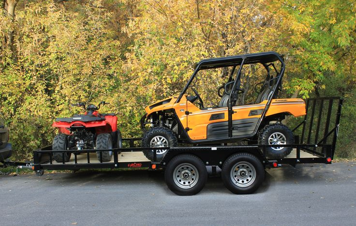 Echo Advantage 17' ATV-UTV Trailer shown with four seat side X side and one large ATV.