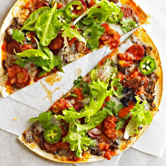 Put a spicy spin on pizza night with this low-calorie take on the popular Mexican street food known as tlayudas. The crispy pizzas use grilled tortillas as crusts, which are then piled with chorizo, Oaxaca cheese, salsa, and all your favorite Mexican toppings.
