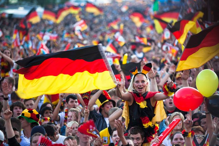 German soccer fans celebrate the kick off of their team's first game at the Euro 2012 at a public viewing zone called 'fan mile' in Berlin, Germany, on June 9. Germany plays against Portugal in Lviv, Ukraine during the Euro 2012 soccer championship. (Markus Schreiber/Associated Press)