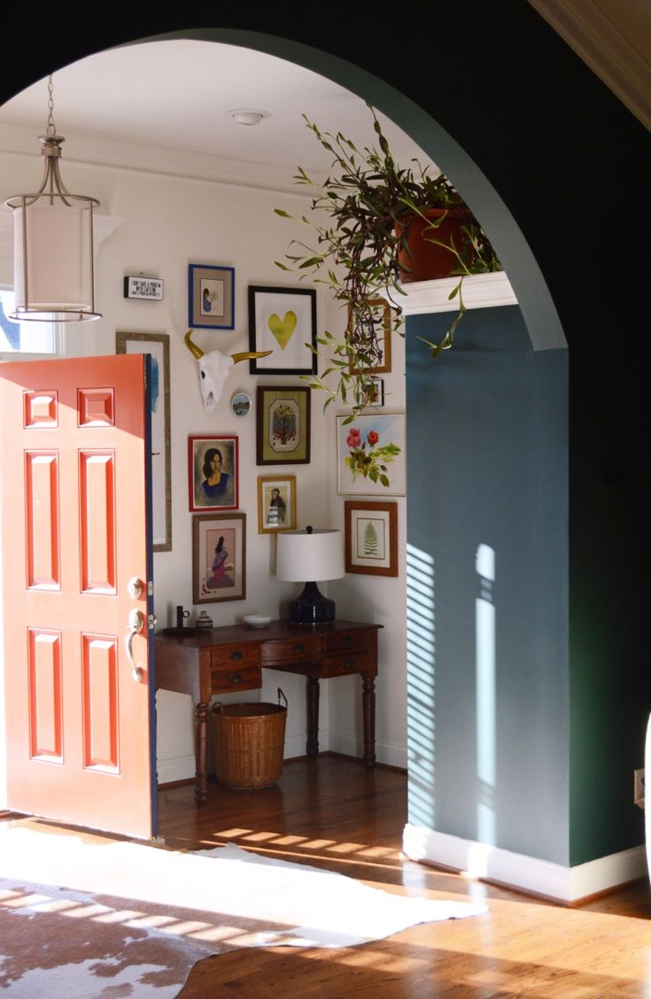 A mixture of art and beautiful color combination add wow factor in this foyer-design addict mom