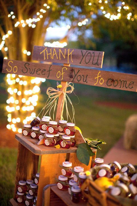 Display tiny pots of locally made honey, a sweet thank-you favor for wedding guests, on pedestals of rustic crates. How cute are these?